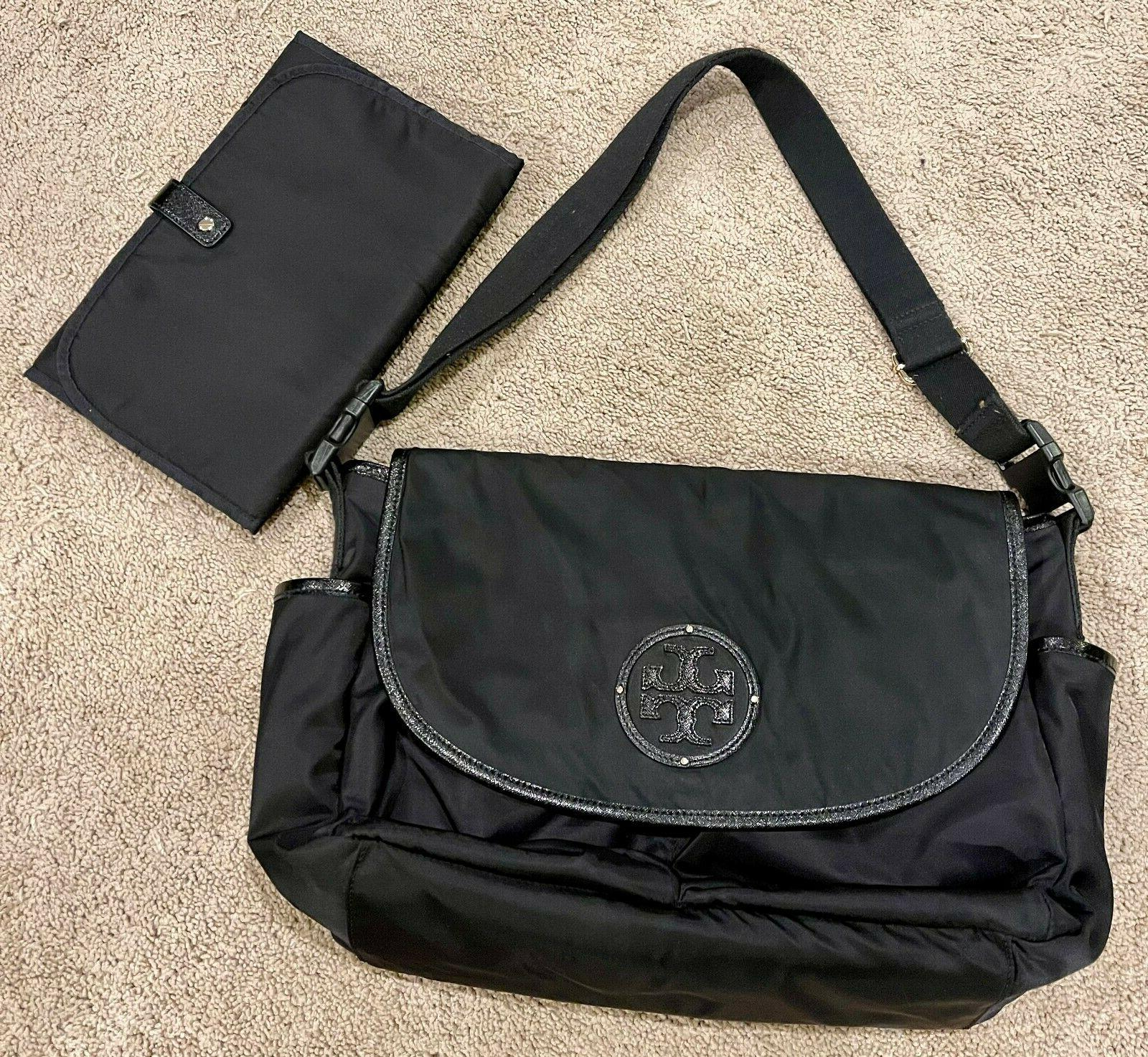 black messenger diaper bag with changing pad